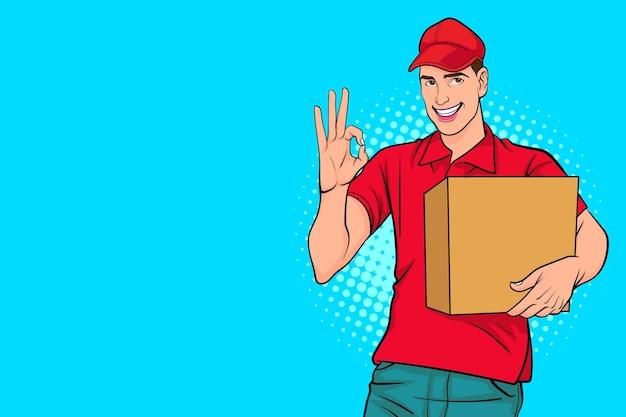 Impiegato del fattorino in berretto rosso con una grande scatola che mostra il gesto ok in stile fumetto retrò pop art