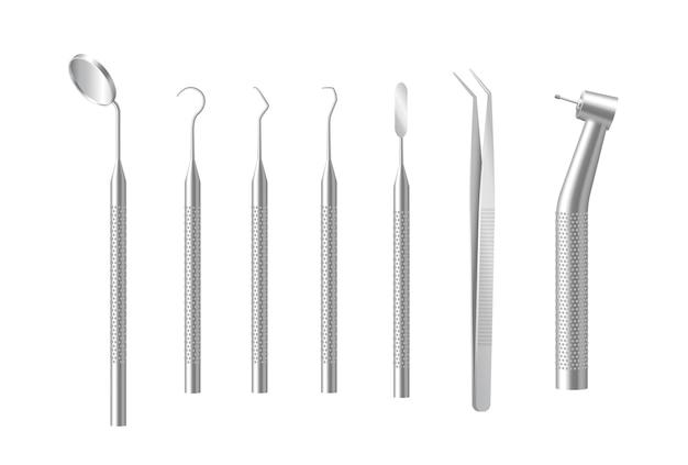 Set di strumenti dentali isolato su bianco