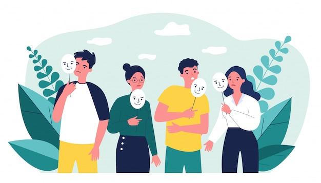 Ragazzo e ragazze depressi che tengono le maschere positive sui bastoni