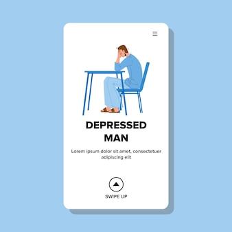 Uomo depresso che si siede al tavolo e piangendo