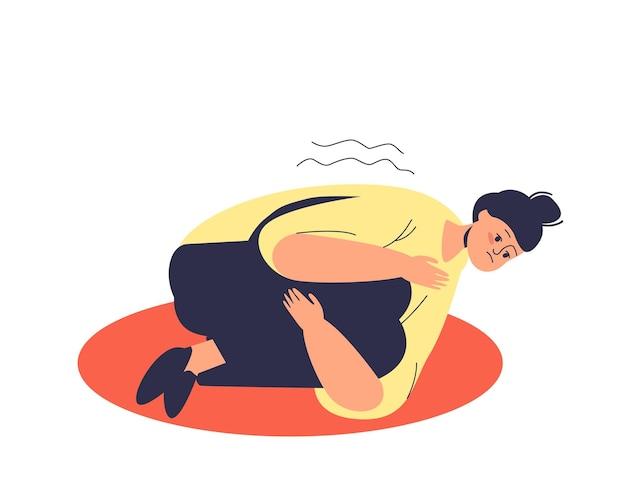 Donna depressa con attacco di panico sdraiato sul pavimento che abbraccia le sue ginocchia