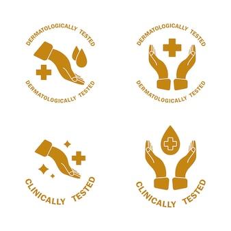Etichetta dorata dermatologicamente testata clinicamente con croce a mano con goccia d'acqua approvato dal punto di vista medico