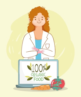 Pomodoro e carota del computer portatile di medico del dietista, alimento sano organico del mercato di prodotti freschi con la frutta e le verdure