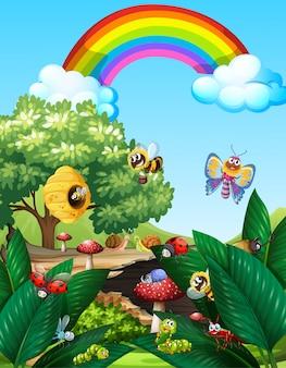 Diversi insetti che vivono nella scena del giardino durante il giorno con l'arcobaleno