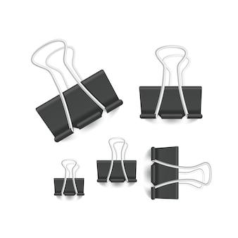 Collezione di elementi per ufficio graffetta di diverse dimensioni isolata su bianco