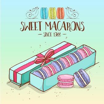 Diversi tipi di macarons nella scatola con nastro, schizzo disegnato a mano e colore.