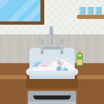 Piatti sporchi nel lavello della cucina