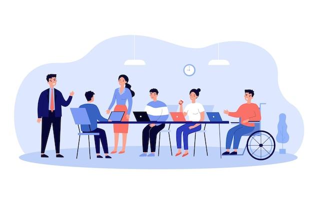 Dipendente disabile in sedia a rotelle impegnato in riunioni e conversazioni aziendali