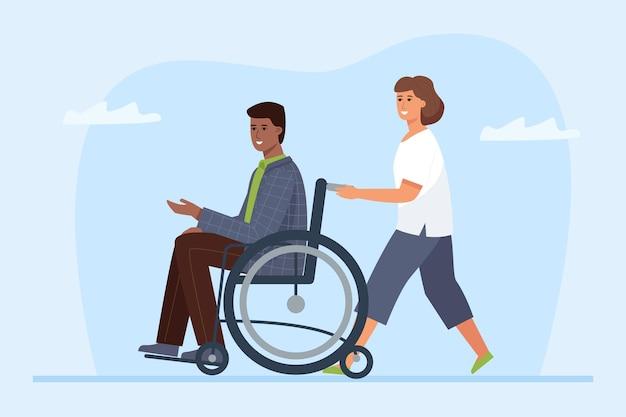 Disabile su sedia a rotelle e volontario. amicizia e sostegno tra un paralitico e il suo assistente.