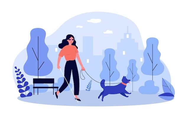 Donna disabile che cammina con il cane guida