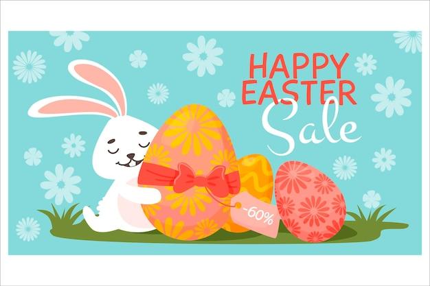 Banner di sconto. uova di pasqua, erba coniglietto con un uovo regalo. sconti di pasqua.
