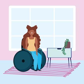 Diversità e inclusione, donna afroamericana seduta sulla sedia a rotelle in casa
