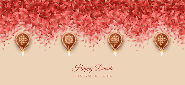 Modello rangoli del diwali o pongal festival realizzato con petali e lampade diya accese