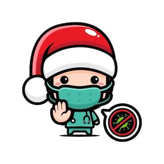 Il dottore indossa un cappello da babbo natale con una posa per fermare il virus