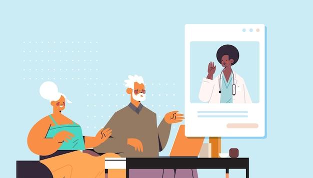 Medico nella finestra del browser web che consulta i pazienti anziani consultazione in linea servizio sanitario medicina consulenza medica ritratto