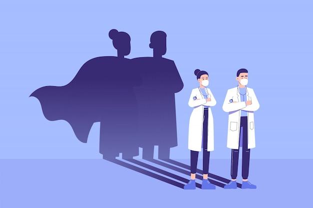 Medici in piedi con sicurezza e l'ombra del supereroe appare dietro al muro