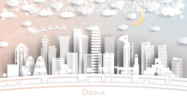 Orizzonte della città di doha qatar in stile taglio carta con fiocchi di neve, luna e ghirlanda al neon. illustrazione di vettore. concetto di natale e capodanno. babbo natale sulla slitta.