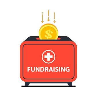 Scatola di donazione in cui cade la moneta. aiutare chi ha bisogno di cure.