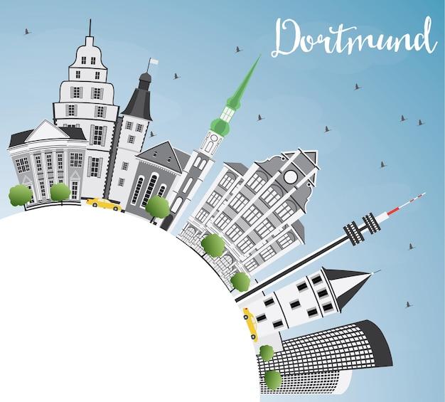 Orizzonte di dortmund con edifici grigi, cielo blu e spazio di copia. illustrazione di vettore. viaggi d'affari e concetto di turismo con architettura storica. immagine per presentazione banner cartellone e sito web.