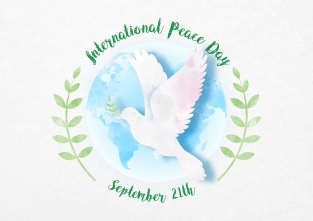 Pace delle colombe con il giorno e il nome della campagna su un ramo globale e ulivo in carta tagliata e stile acquerelli su carta bianca.