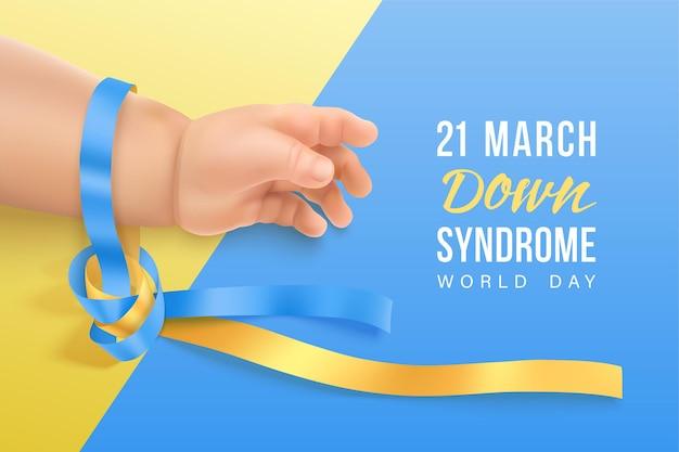 Banner di sindrome di down con nastro fotorealistico blu e giallo sulla mano del bambino.