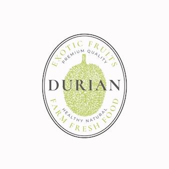 Distintivo con cornice ovale durian o modello logo schizzo di frutta disegnata a mano con tipografia retrò e bordi ...