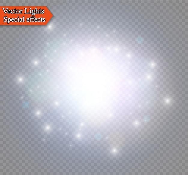 La polvere scintilla e le stelle dorate brillano di luce speciale. brilla su uno sfondo trasparente. effetto luce di natale. particelle di polvere magica scintillante.