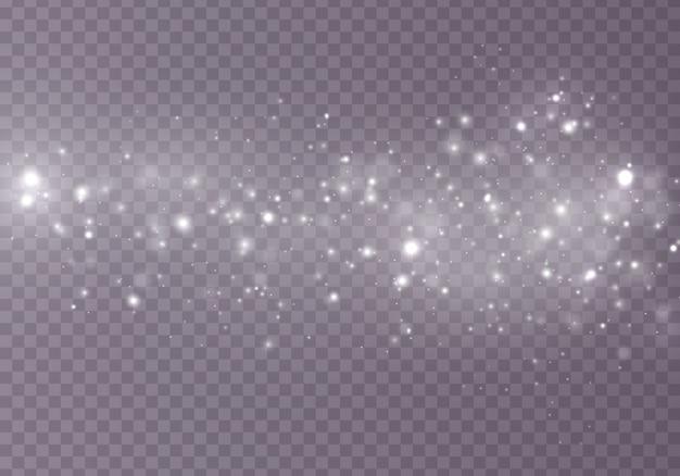 Scintille di polvere e stelle dorate brillano di luce speciale su trasparente
