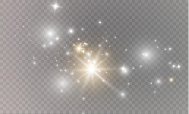 Polvere su uno sfondo trasparente. stelle luminose. effetto luce bagliore.