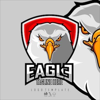 Modello logo eagle esports con sfondo grigio