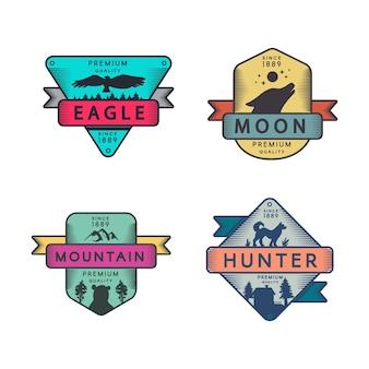 Aquila e montagna, luna e distintivi del cacciatore impostare il logo.