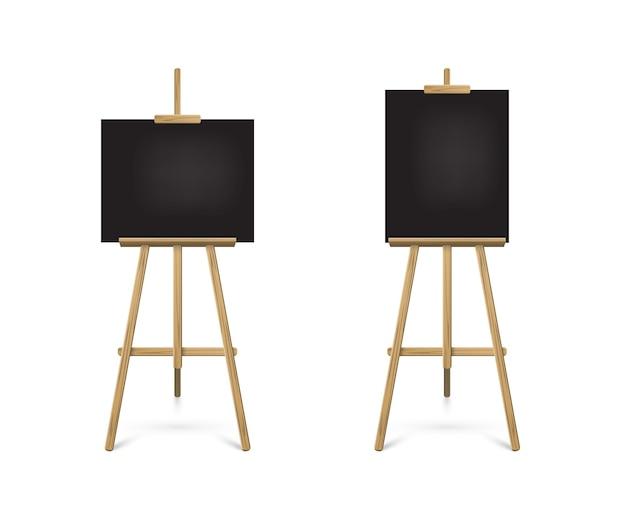 Cavalletto in piedi con tavole nere su treppiede in legno per disegno o annuncio di pittura artistica