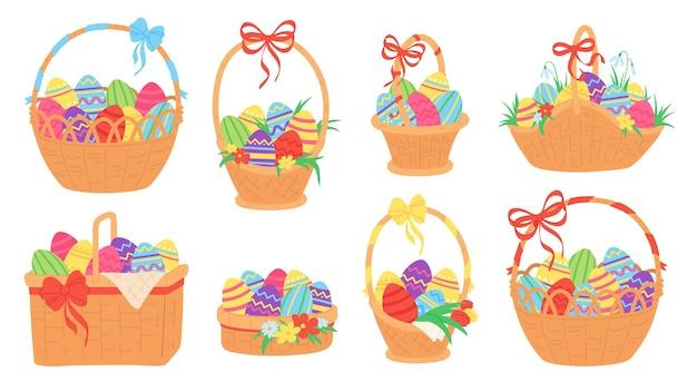 Cesti pasquali. uova di cioccolato dipinte in cesto di vimini con fiore di nastro, erba, tulipano e bucaneve. insieme di vettore di vacanza tradizionale primavera. illustrazione cesto pasquale con uova