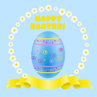 Uovo dipinto di blu di pasqua e nastro dorato