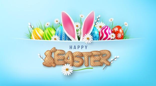 Modello di carta di pasqua con uova di pasqua e simpatico coniglietto e lettere biscotto su sfondo verde chiaro.