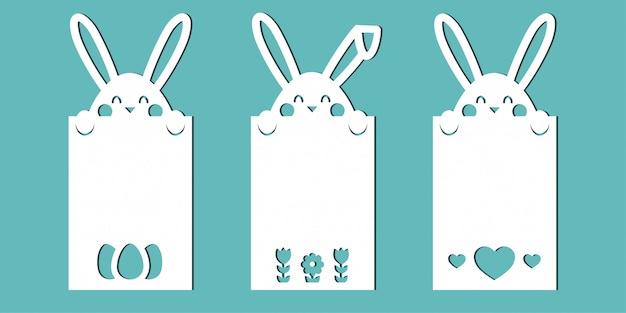 Carte pasquali con i coniglietti un set di modelli per il taglio della carta, il taglio laser o il plotter. Vettore Premium