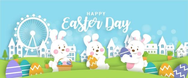 Banner di giorno di pasqua con conigli carini e uova di pasqua