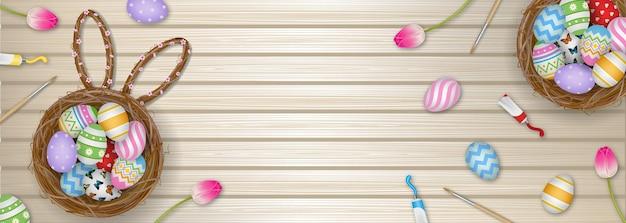 Banner di giorno di pasqua con uova nel nido e fiori