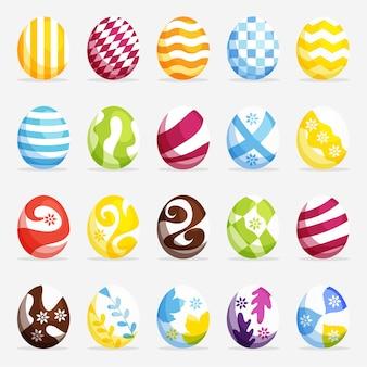 Collezione di uova di pasqua di diversi modelli e colori vettore premium