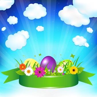 Uova di pasqua con nastro, fiori ed erba,