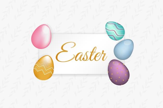 Design del telaio di pasqua con scritte in oro e uova di pasqua colorate