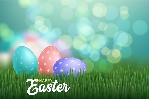 Biglietto di auguri di pasqua con uova colorate sulla natura