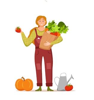 Mangiare prodotti biologici locali concetto di vettore del fumetto. illustrazione variopinta della scatola della tenuta della ragazza del carattere dell'agricoltore felice con le verdure coltivate design ecologico del mercato per la vendita di prodotti agricoli