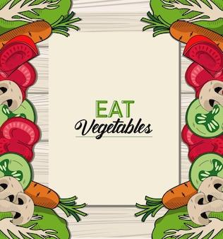 Mangia scritte di verdure con cornice di cibo sano