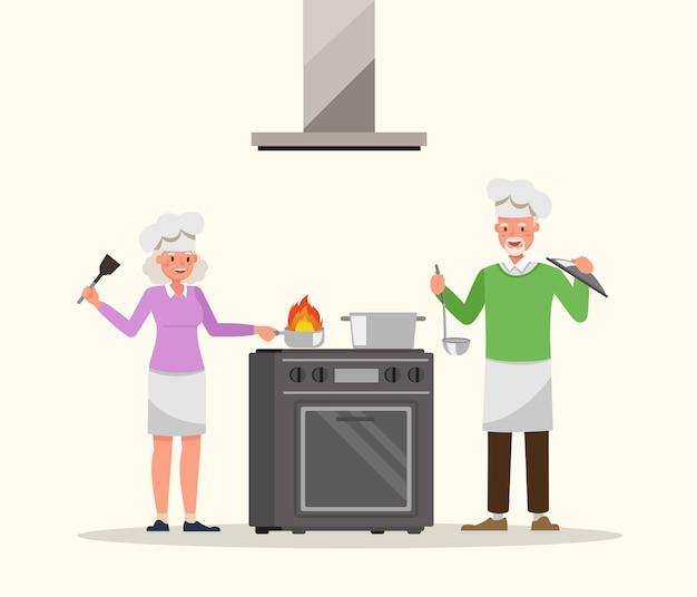 Coppie anziane che cucinano nel carattere della cucina
