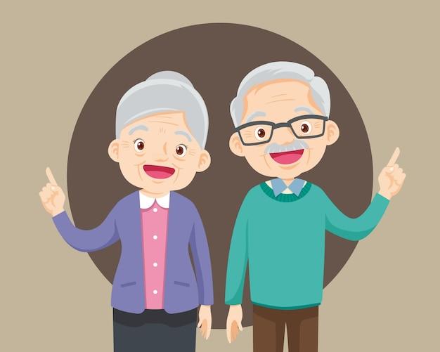 Coppia di anziani puntare il dito sull'illustrazione