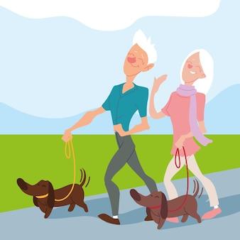 Coppia di anziani a spasso con i cani nel parco, design per anziani attivi