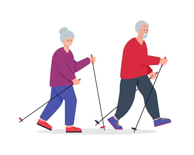Coppia di anziani che cammina con i poli nordici nel parco cittadino senior pe active leisure stile di vita sano