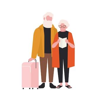 Coppia di anziani con valigia isolata su bianco