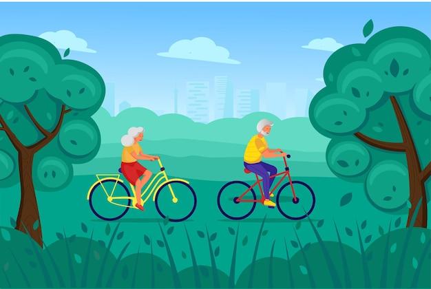 Un uomo e una donna anziani vanno in bicicletta nel parco